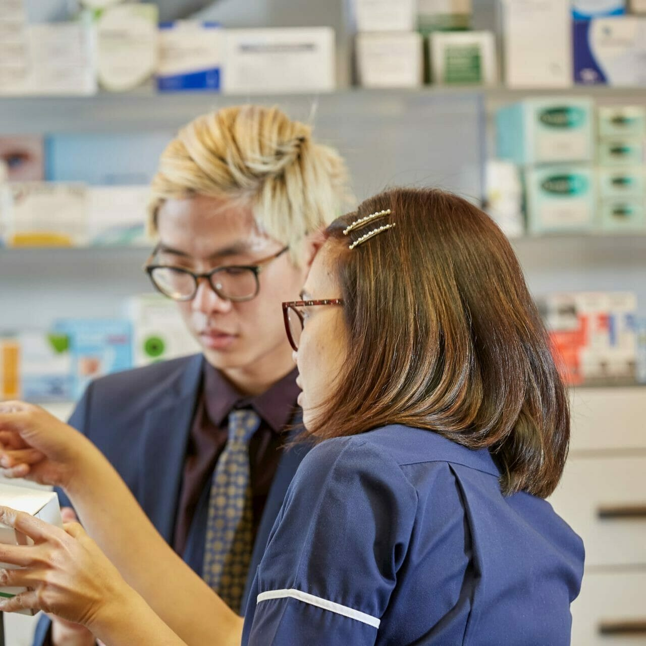 Two pharmacists in a pharmacy